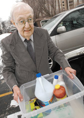 Indianapolis Legal Aid attorney Orville Copsey with the cleaning supplies he keeps in his car.